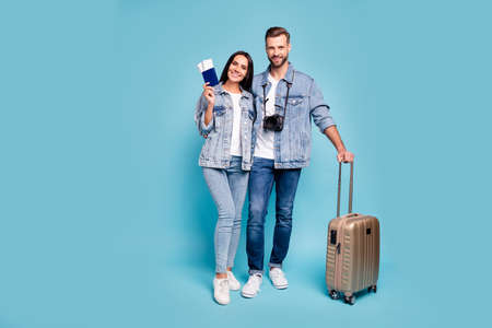 Full body photo of married people holding pack hug embrace wear trendy denim jeans jackets isolated over blue background
