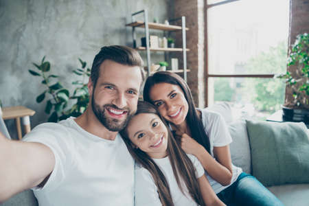 Self-portrait of nice attractive lovely sweet gentle adorable winsome charming cheerful cheery idyllic adopted foster family mommy daddy enjoying life indoors Stock Photo