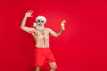 Portrait of his he nice attractive handsome cheerful positive glad carefree careless bearded gray-haired man having fun pool resort spa event rejoicing isolated on bright vivid shine red background