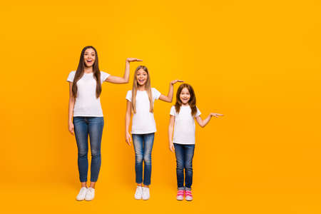 Full size photo of three sister ladies not believe such quick growing up wear casual outfit isolated yellow background