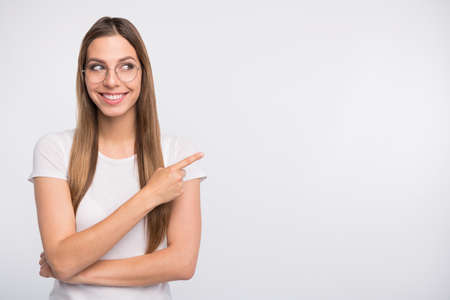 Salesperson lady indicating finger empty space on sale banner wear specs and t-shirt isolated white background