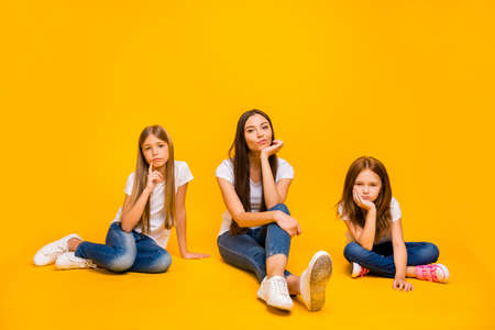 Full size photo of amazing three ladies sitting floor not interested in talk wear casual clothes isolated yellow background