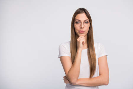 Photo of pretty lady looking with interest arm touch chin wear specs and t-shirt isolated white background