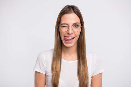 Photo of funky lady tempting lick lips and blink eye wear specs and t-shirt isolated white background