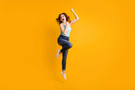 Full length photo of jumping high lady celebrate best achievement wear casual outfit isolated yellow background 写真素材