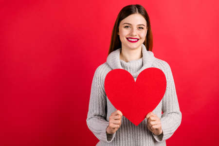 Photo of amazing lady with large paper heart wear knitted pullover isolated red background