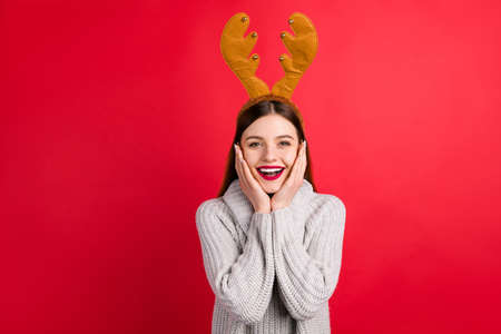 Photo of pretty lady glad to see relatives wear head horns and knitted jumper isolated red background