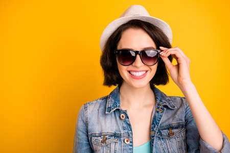 Photo of gorgeous nice cute lovely girl showing you her sunglass hiding eyes behind them while isolated with vivid background Stock Photo