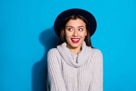 Pretty lady looking empty space cheerful laughing wear warm knitted pullover isolated blue background