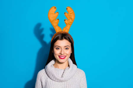 Photo of pretty lady wear toy horns knitted pullover isolated blue background Фото со стока