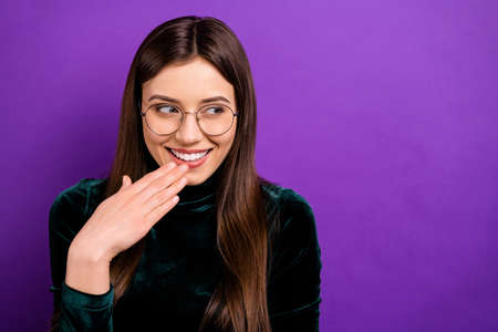 Close up photo of excited lovely teen laughing looking wearing eyeglasses, eyewear isolated over purple violet background 免版税图像