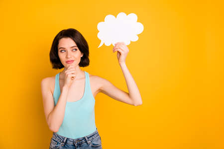 Photo of cheerful nice cute attractive cunning girlfriend waiting for her cloud to be fulfilled while isolated with yellow background