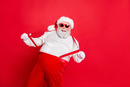 Ho-ho-ho holly jolly noel. Photo of cheerful laughing grandfather pulling holding boasting suspenders on trousers having fun time on vacation weekend isolated bright background