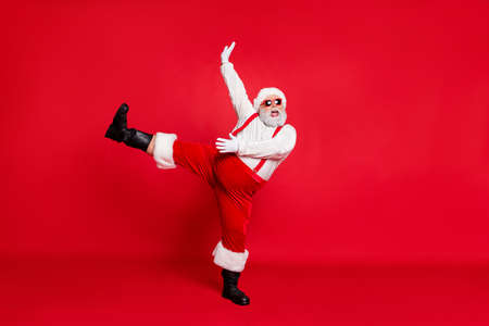 X-mas newyear time concept. Photo of overweight with round belly fatty nice positive emotional modern screaming shout singing carols grandfather moving legs hand in air isolated bright background Stock Photo