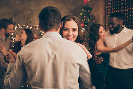 Backside close up photo of lovely lady dancing with her sweetheart on christmas night x-mas party meeting with her fellows have formal wear in house indoors Stock Photo
