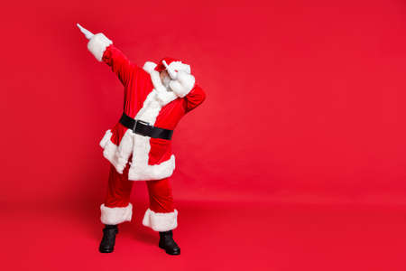 Full length body size view of his he carefree fat overweight plump gray-haired bearded man St Saint Nicholas having fun christmastime occasion isolated over bright vivid shine red background