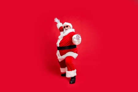 Full length body size view of his he cheerful cheery fat overweight gray-haired bearded man St Saint Nicholas having fun isolated over bright vivid shine red background Reklamní fotografie