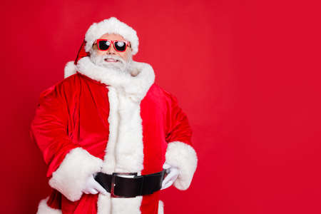 Portrait of his he cheerful cheery confident content fat overweight plump gray-haired bearded man winter christmastime fairy isolated over bright vivid shine red background Archivio Fotografico - 129822868