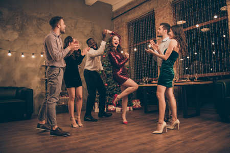 Full body photo of cheerful man and woman dancing enjoying christmas party x-mas holidays wearing dress high heels white plaid shirt pants in house with newyear illumination indoors