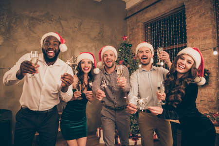Portrait of crazy lovers having glass with champagne give toast celebrate christmas time at x-mas party in house indoors