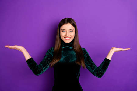 Portrait of cheerful youth holding hands smiling at camera isolated over purple violet background Stock Photo