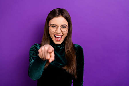 Portrait of cheerful youth pointing laughing wearing eyeglasses eyewear isolated over purple violet background
