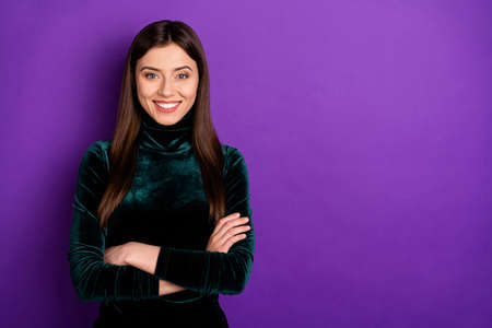 Portrait of lovely lady youth with her hands folded looking at camera isolated over purple violet background