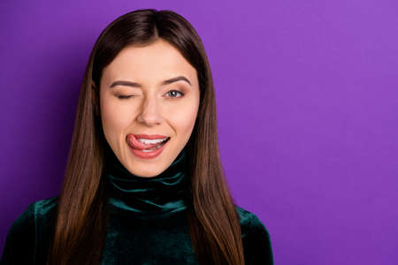 Close up photo of lovely lady blinking licking her lips isolated over purple violet background Фото со стока - 129823109