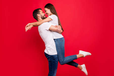 Profile side view portrait of his he her she nice attractive lovely trendy cheerful cheery married spouse spending honeymoon vacation having fun leisure isolated over bright vivid shine red background Stock fotó