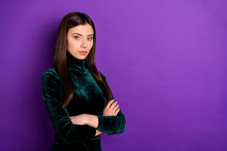 Portrait of pretty concentrated person crossing her arms looking at camera isolated over purple violet background