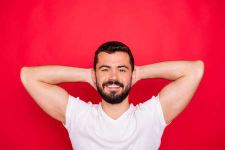 Photo of handsome attractive kind good trendy man having rest with hands holding head while isolated with red background