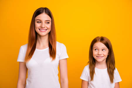Portrait of lovely ladies looking with beaming smile isolated over yellow background Stock Photo