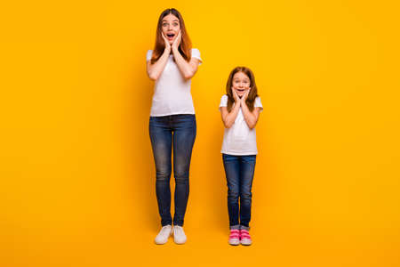 Full body photo of impressed people touching their face isolated over yellow background Stock Photo