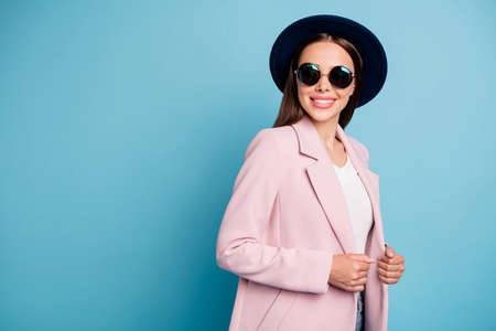 Portrait of charming attractive good look girl have promenade rest with her friends wear vintage topcoat vercoat isolated over blue color background Stock Photo