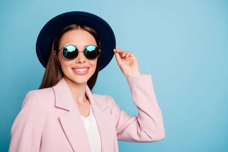Close up photo of cute enthusiastic hipster girl have fun on stroll enjoy her vacation wear pink autumn coat isolated over blue color background