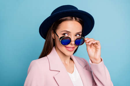 Close up photo of interested woman touch her retro vintage specs look want flirt handsome guy wear pink topcoat isolated over blue color background