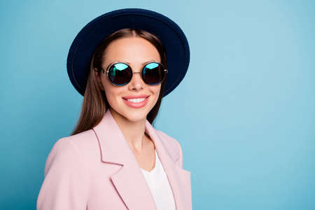 Close up photo of optimistic nice lady having stroll enjoy her vacation wearing retro outfit chic clothes isolated over blue color background