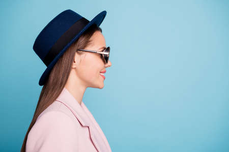 Profile side photo of cute pretty girl having promenade with her best friends wear vintage eyewear eyeglasses season coat isolated over blue color background