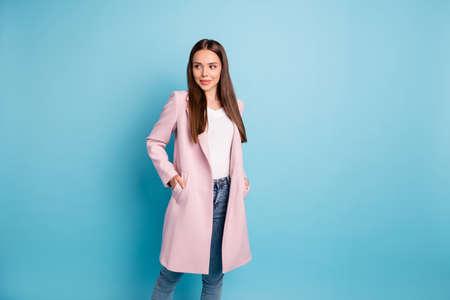 Photo of amazing lady enjoy warm weather wear pastel color demi-season coat and jeans isolated on blue background Stock Photo