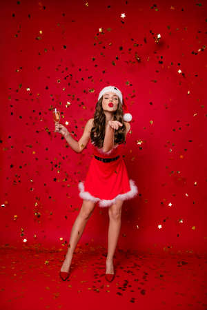 Vertical full length body size view of nice attractive lovely lovable flirty gorgeous slim fit cheerful cheery wavy-haired lady sending you kiss greeting isolated on bright vivid shine red background