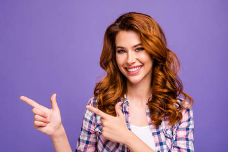 Photo of amazing foxy lady indicating fingers empty space advising sale shopping wear casual plaid shirt isolated purple color background Stock fotó