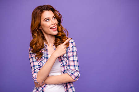 Photo of amazing foxy lady indicating finger empty space advising cheap shopping wear casual plaid shirt isolated purple color background