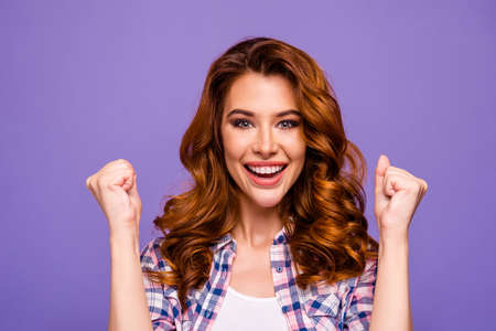 Photo of pretty foxy lady celebrating favorite football team success raising fists wear plaid casual shirt isolated purple color background