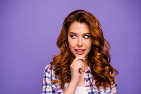 Photo of pretty foxy lady look wondered to empty space watching interesting happening wear checkered casual shirt isolated purple color background