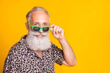 Close up photo of old man pensioner having been retired and sent to have rest abroad enjoying life while isolated with yellow background