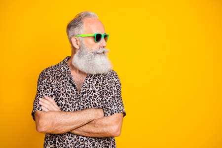 Profile side photo of modern funny funky old long bearded man traveling look forever young wearing green eyeglasses eyewear isolated over yellow background