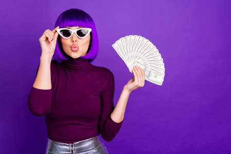 Photo of stylish lady holding fan of american bucks send air kiss wear trendy outfit isolated purple background