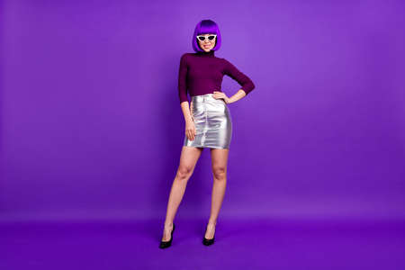 Full body photo of millennial lady wear sun specs trendy outfit isolated purple background