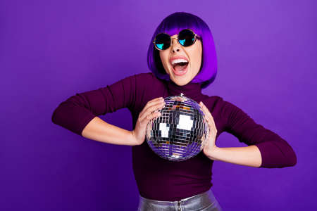 Portrait of wild millennial with eyeglasses eyewear screaming wearing turtleneck silver skirt isolated over purple violet background