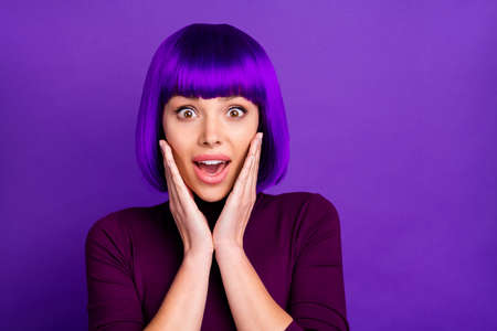 Close up photo of impressed youth touching her cheeks wearing turtleneck isolated over purple violet background